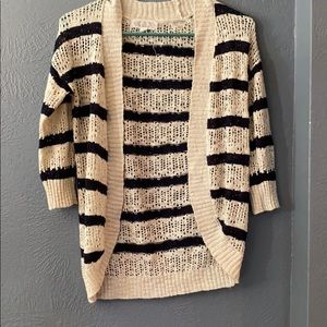 Cardigan with 3/4 length sleeves.